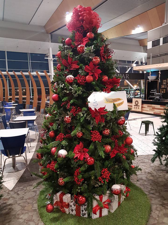 Christmas Tree Masterpiece, Wellington Airport Red Baubles, Flowers and Berries